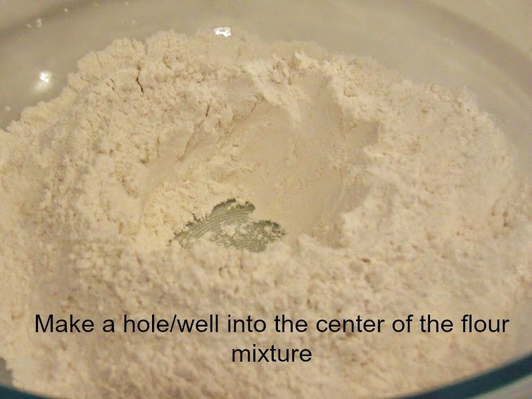 Make a hole or well in the center of the dry flour mixture